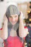 Portrait of a pretty brunette in grey hat — Fotografia Stock