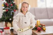 Festive little girl holding a cracker — Stock Photo