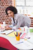 Female interior designer at office desk — Stock Photo
