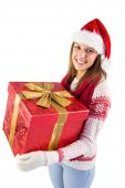Young woman holding a gift while smiling at camera  — Stock Photo