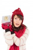 Young woman shaking her gift — Stock Photo