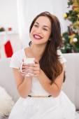 Smiling brunette holding a mug — Foto de Stock