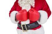 Mid section of santa with boxing gloves — Stockfoto