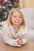 Festive little girl smiling at coffee table — Stock Photo