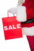 Santa claus holding sale bag  — Foto de Stock
