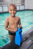Boy holding flippers by pool — Stock Photo