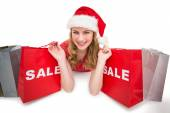 Smiling woman lying between sale shopping bags — Foto Stock