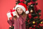 Festive little girl holding gift — Foto Stock