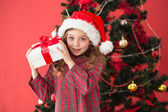 Festive little girl holding gift — Stock Photo