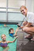 Pretty swimming coach smiling at camera — Foto Stock