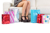 Woman with purchases and shopping bag on the floor — Stock Photo