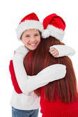Festive mother giving daughter a hug — Stock Photo