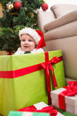 Cute baby boy in large christmas present — Zdjęcie stockowe