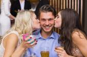 Happy friends having a drink together — Stock Photo