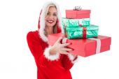 Festive blonde holding pile of gifts — Stock Photo