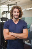 Handsome trainer with arms crossed — Stock Photo