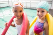 Cute little girls smiling poolside — Stock Photo