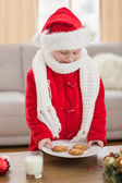 Festive little boy holding plate of cookies — Foto Stock