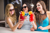 Attractive friends drinking cocktails together — Stock Photo