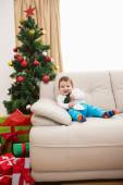 Cute baby boy on couch at christmas — Zdjęcie stockowe