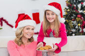 Festive mother and daughter with plate of cookies — Stock Photo