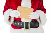 Mid section of santa claus holding box — ストック写真