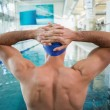 Shirtless fit swimmer by pool at leisure center — Stock Photo #60655161