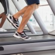 Fit people running on treadmills — Stock Photo #60659429