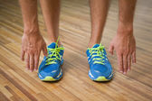 Low section of man in sports shoes in fitness studio — Stock Photo