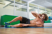 Portrait of a shirtless man doing fitness exercise — Stock Photo