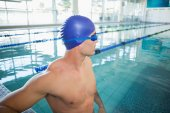 Swimmer looking away in pool at leisure center — Stock Photo