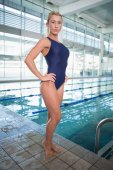 Fit female swimmer by the pool at leisure center — Stock Photo