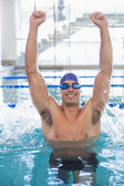 Fit swimmer cheering in pool at leisure center — Stock Photo