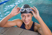 Close up portrait of female swimmer in pool at leisure center — Stock Photo