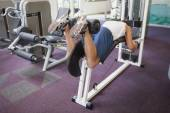 Fit man using weights machine for legs — Stock Photo