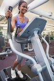 Fit woman working out on the cross trainer — Stockfoto