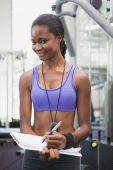 Fit personal trainer smiling at camera — Stock Photo