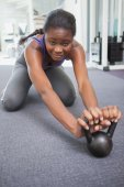 Fit woman working out with kettlebell — Stock Photo