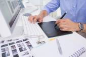 Graphic designer using digitizer at his desk — Stock Photo