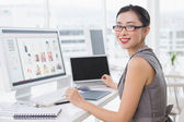 Photo editor working at her desk — Stock Photo