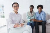 Reconciled couple smiling at camera with therapist — Stock Photo