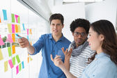 Young creative team brainstorming together — Stock Photo