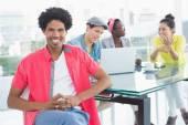 Young creative man smiling at camera — Stock Photo