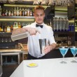 Smiling bartender preparing a drink at bar counter — Fotografia Stock  #60811381