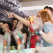 Friends having a drink together and pointing something — Stock Photo #60812077