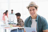 Young creative man using his tablet — Stock Photo