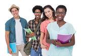 Stylish students smiling at camera together — Stock Photo