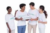 Young smiling volunteers collecting donations — Stock Photo