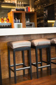 Close up of several bar stool — Foto de Stock