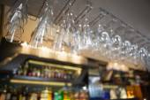 Many wine glasses hanging above the bar — Stock Photo